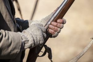 musket and hands